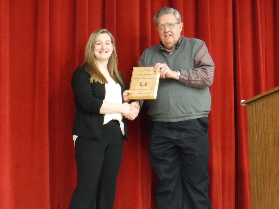Haley Sanford accepts the award for Outstanding Youth Conservationist presented by Jerry Longwell